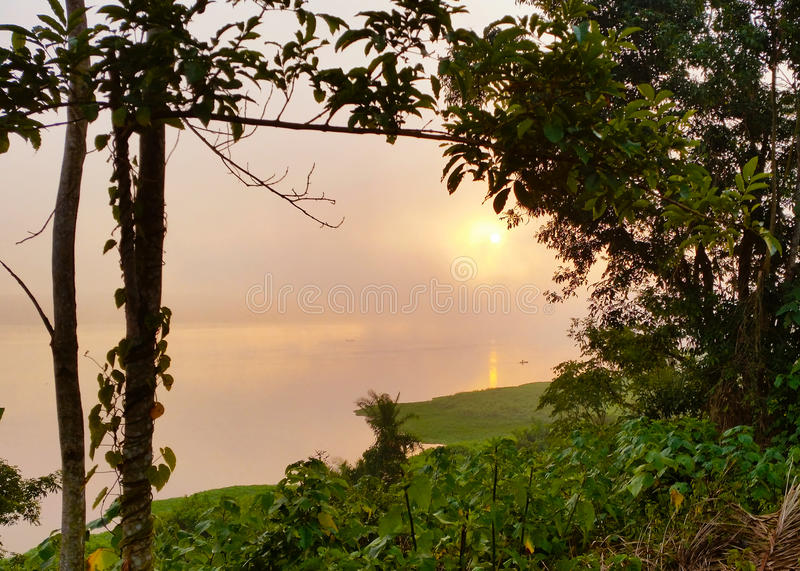 Sunrise of the Nile. Early in the morning when the sun rises the mist over the Nile at its source close to Jinja in Uganda stock photography