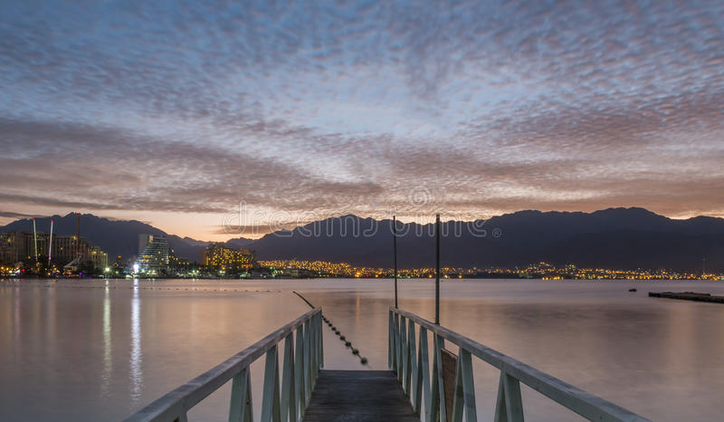 Sunrise at the northern beach of Eilat. Eilat is a famous Israeli city with beautiful beaches and resort hotels packed with thousands of vacationers and relaxing stock images