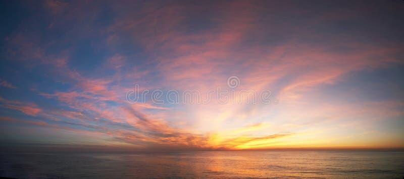 Sunrise at ocean stock photography