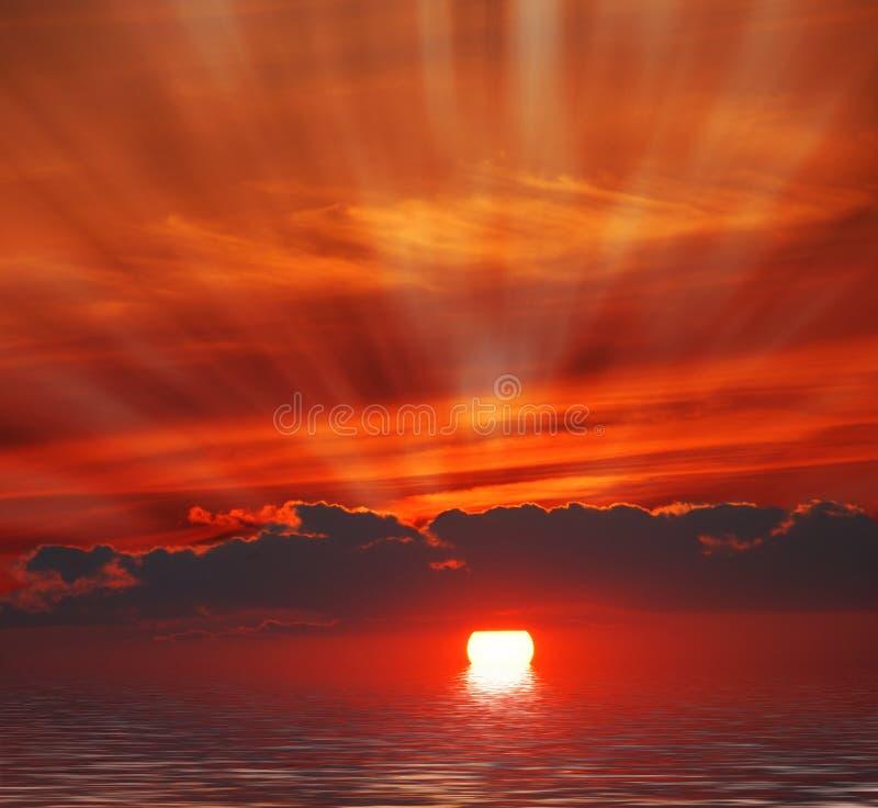 Sunrise in ocean stock images
