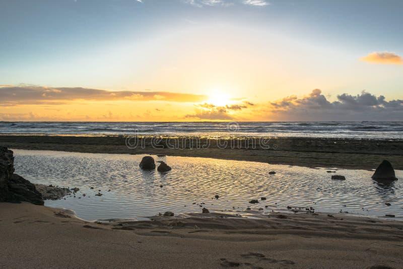 Sunrise on the ocean in Lihue, Hawaii stock image