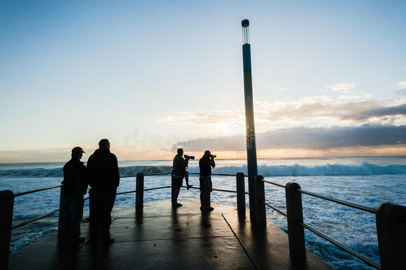 Sunrise Ocean Waves Pier People stock photography