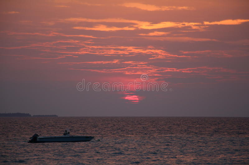 Seeing a boat berthed before the sunrise royalty free stock photos