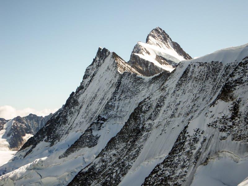 Sunrise over an alpine mountain landscape in Switzerland royalty free stock image