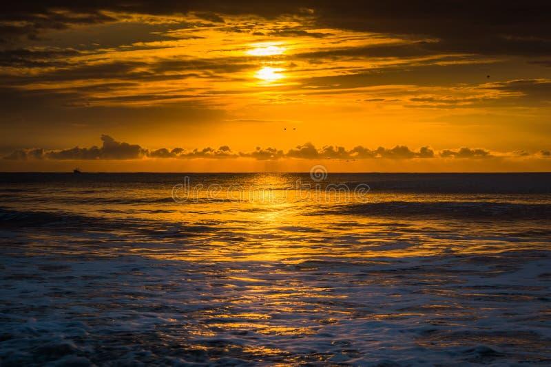 Sunrise over the Atlantic Ocean in Folly Beach, South Carolina. Sunrise over the Atlantic Ocean in Folly Beach, South Carolina stock image