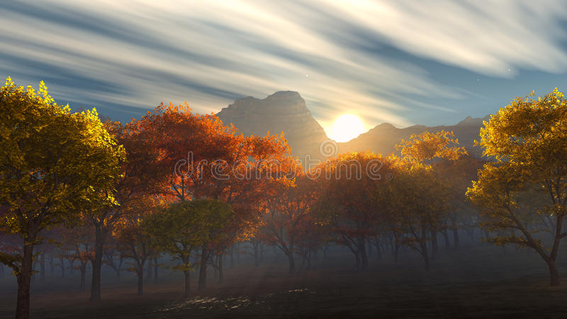 Sunrise over the autumn yellow and red trees stock image