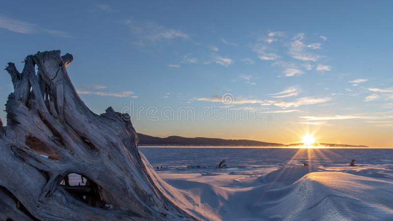 Sunrise over the Bay of Gaspe and the Forillon Peninsula on a cold winter morning. Sunrise over the Bay of Gaspe and the Forillon Peninsula on a cold winter royalty free stock photo