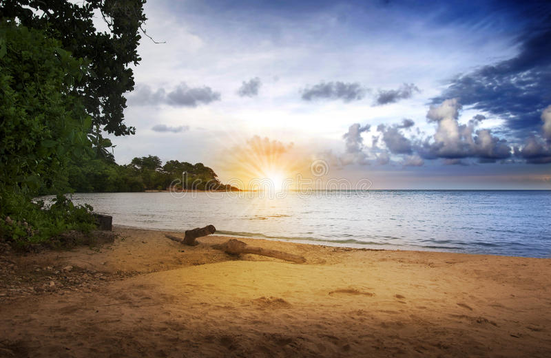 Download Sunrise over beach stock photo. Image of dark, paradise - 15896154