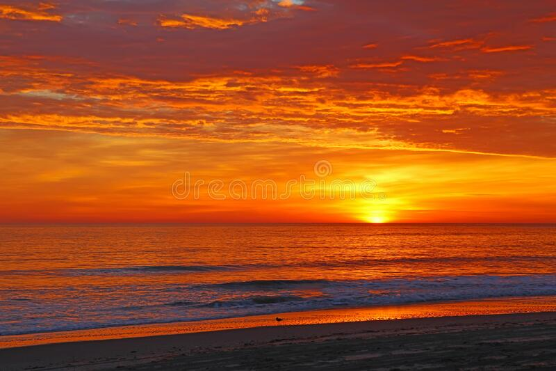 Sunrise over the beach at Nags Head, North Carolina. Sunrise over the Atlantic ocean to illuminate the sandy beach at Nags Head on the Outer Banks of North royalty free stock images