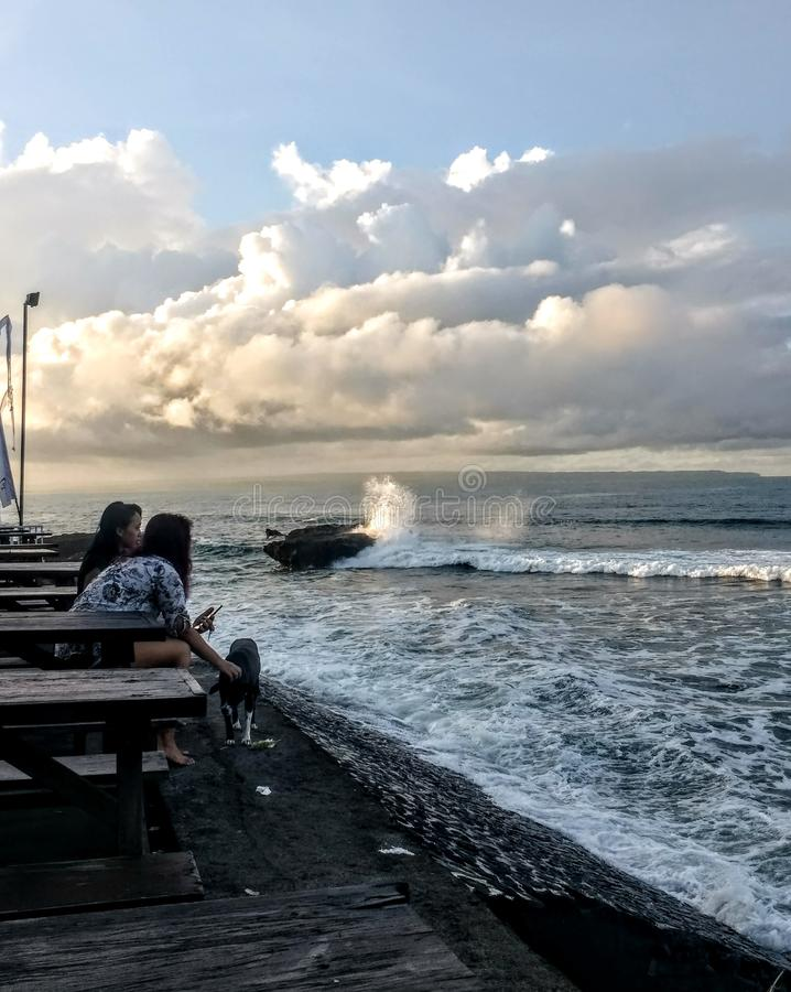 Sunrise over black sand beach in Bali Indonesia royalty free stock images