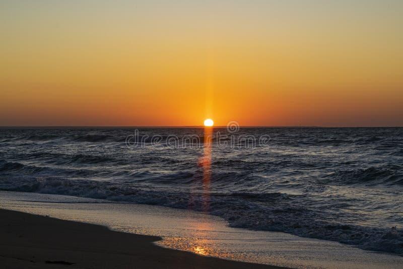 Sunrise over the Black sea, waves on the sandy beach.  royalty free stock photos