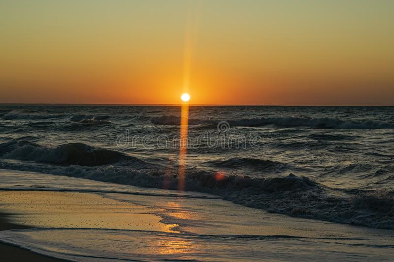 Sunrise over the Black sea, waves on the sandy beach.  stock images