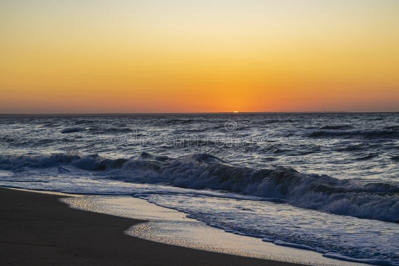 Sunrise over the Black sea, waves on the sandy beach.  stock image