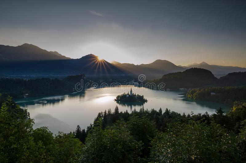 Sunrise over Bled lake with St. Marys Church of the Assumption on the small island. Bled, Slovenia, Europe stock photography