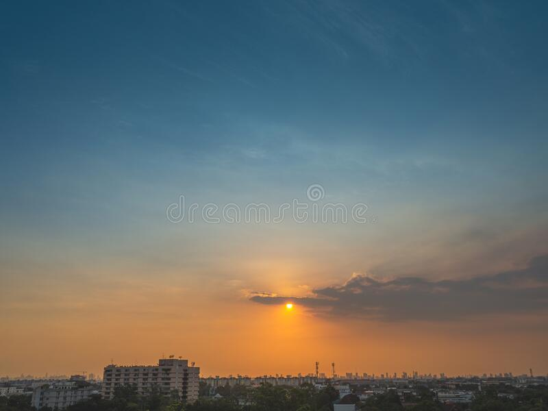 Sunrise over buildings in city. Skyline view of cityscape with sunlight  in warm light color tone. Sunrise over buildings in city. Skyline view of cityscape royalty free stock photo