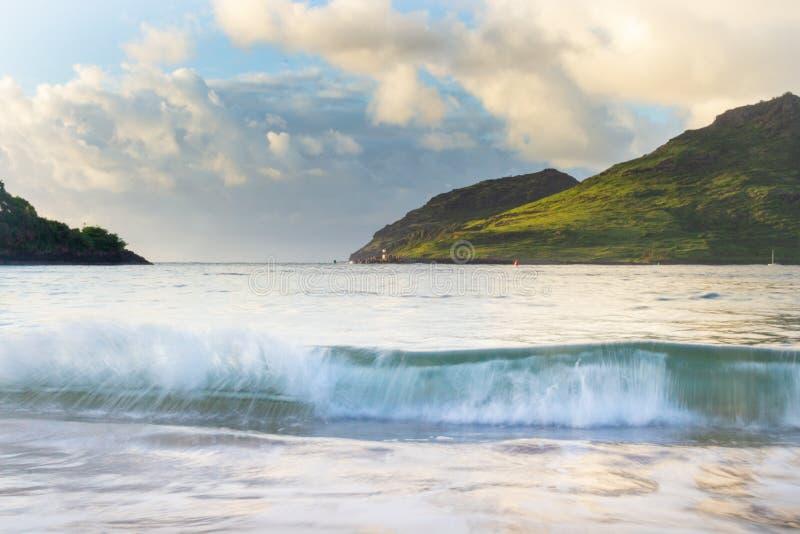Sunrise over a calm ocean in Kauai, Hawaii royalty free stock photography