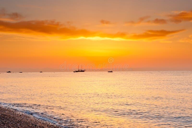 Download Sunrise    Over The Calm Sea In Orange Tones Stock Photo - Image: 33393040