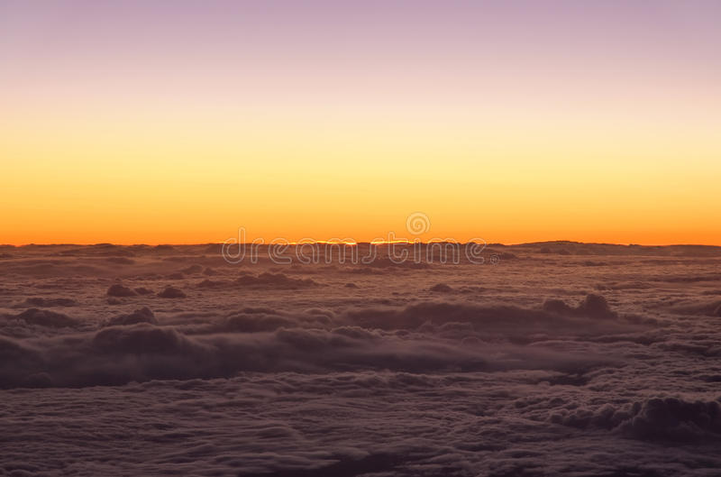 Sunrise over the clouds royalty free stock image