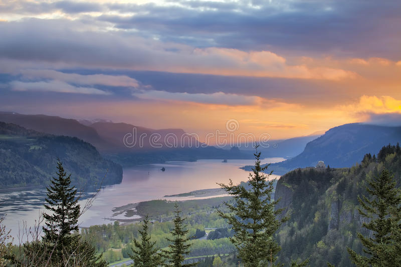 Sunrise Over Crown Point at Columbia River Gorge. Sunrise Over Vista House on Crown Point at Columbia River Gorge in Oregon with Beacon Rock in Washington State stock image