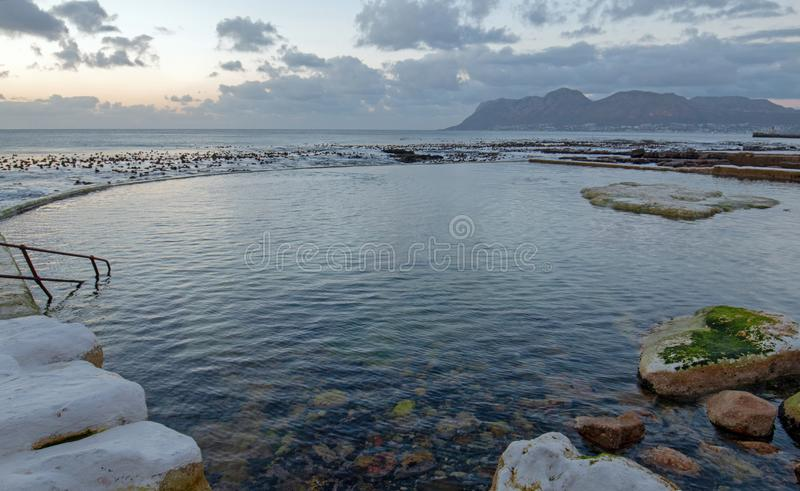Dawn Sunrise over Dale Brook Tidal Swim Pool in Cape Town South Africa stock photos