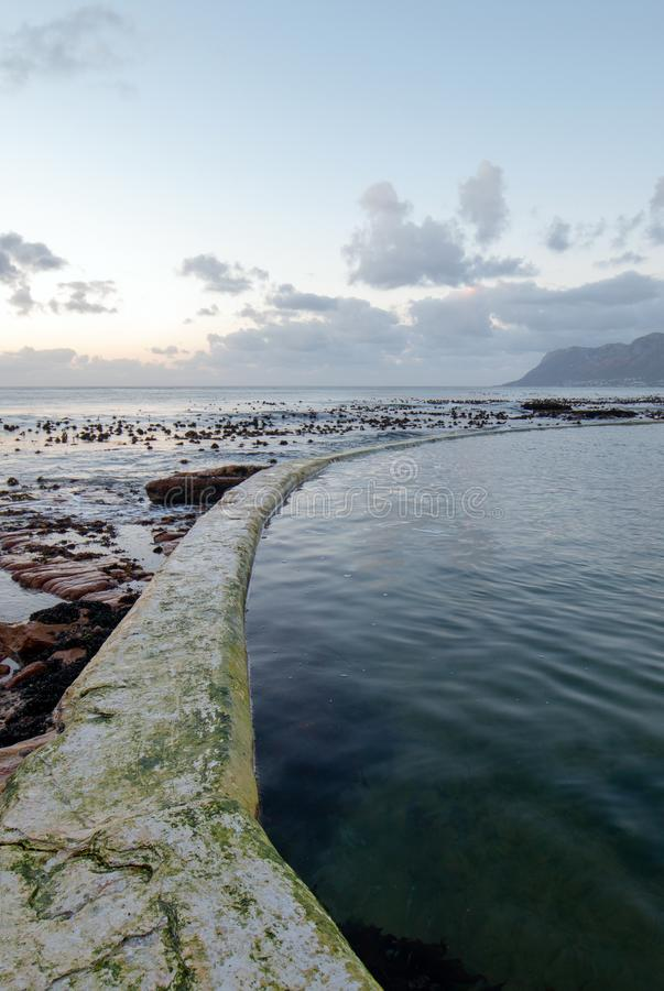 Sunrise over Dale Brook Tidal Swim Pool seawall in Cape Town South Africa SA stock photography