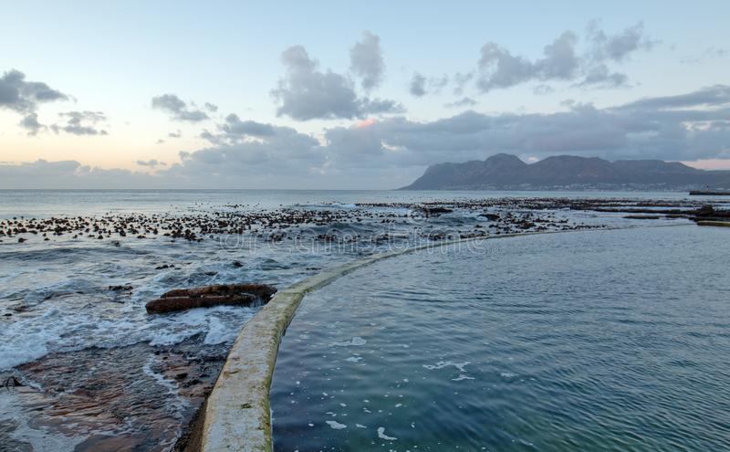 Sunrise over Dale Brook Tidal Swim Pool seawall in Cape Town South Africa SA royalty free stock photography