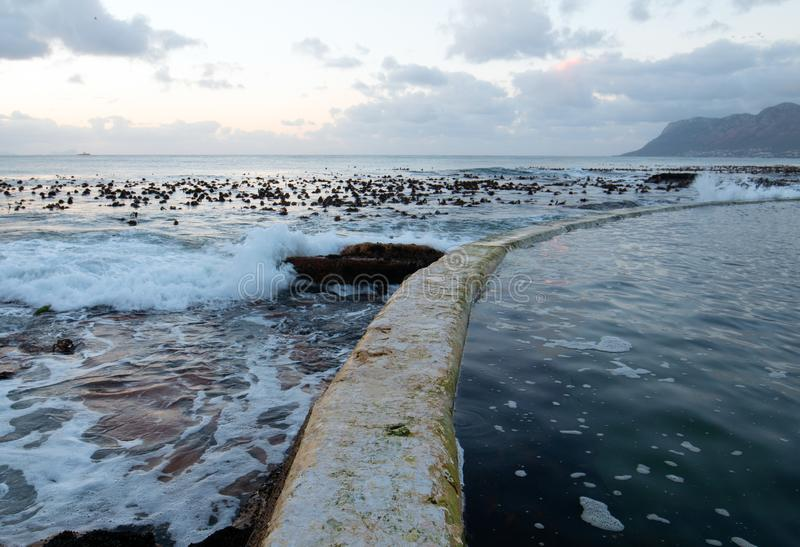 Sunrise over Dale Brook Tidal Swim Pool seawall in Cape Town South Africa SA royalty free stock images