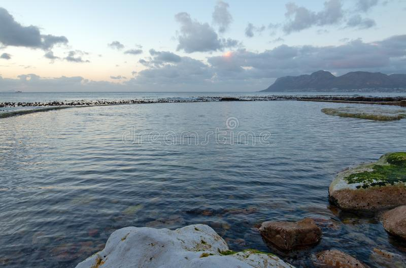 Dawn Sunrise over Dale Brook Tidal Swim Pool in Cape Town South Africa royalty free stock images
