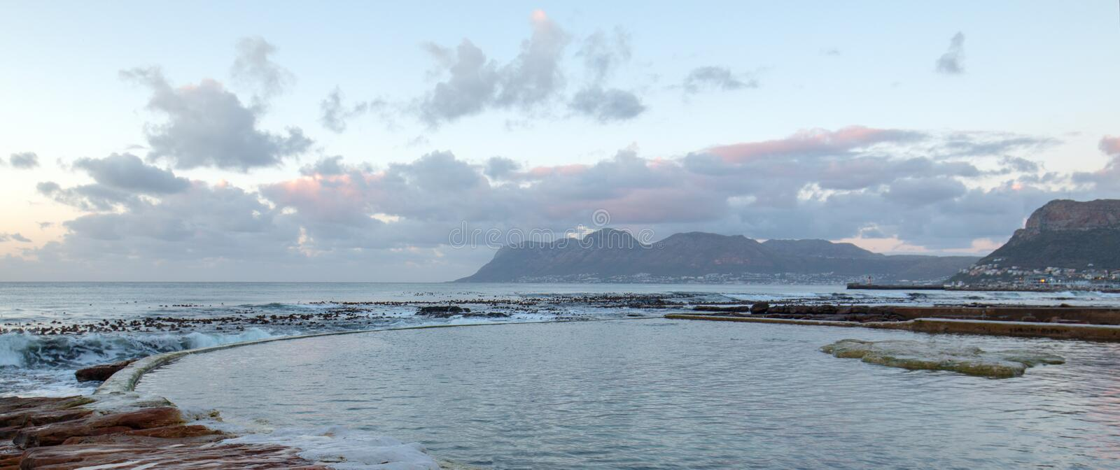 Early morning Dawn Sunrise over Dale Brook Tidal Swim Pool in Cape Town South Africa royalty free stock photos