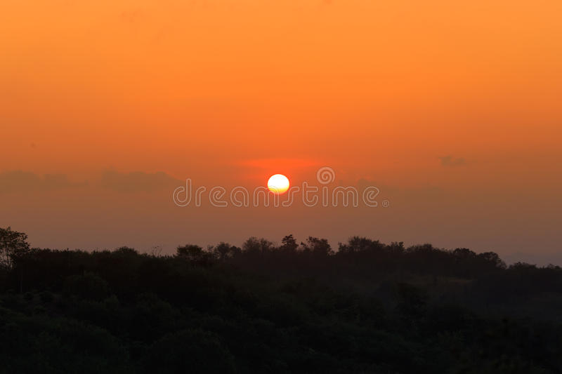 Sunrise over the distant hills stock photo
