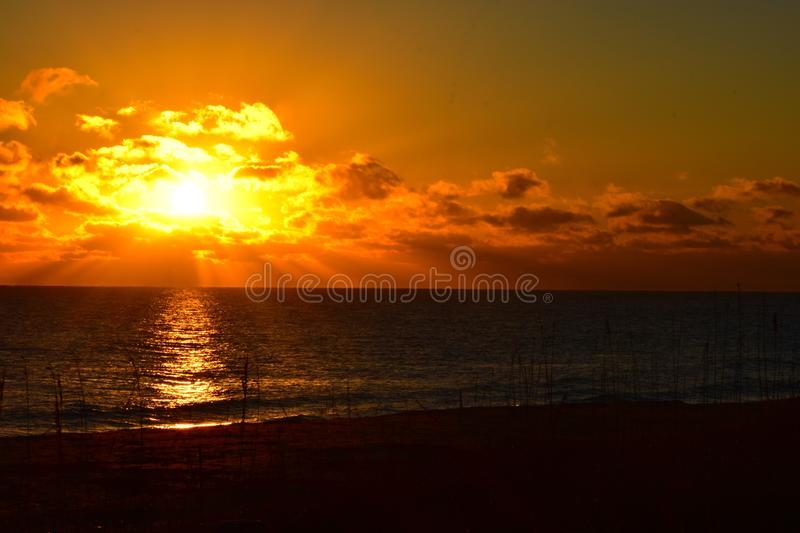 Sunrise over the east coast of Florida. Beautiful golding sunrise with yellow and orange clouds decorates the morning sky royalty free stock photos
