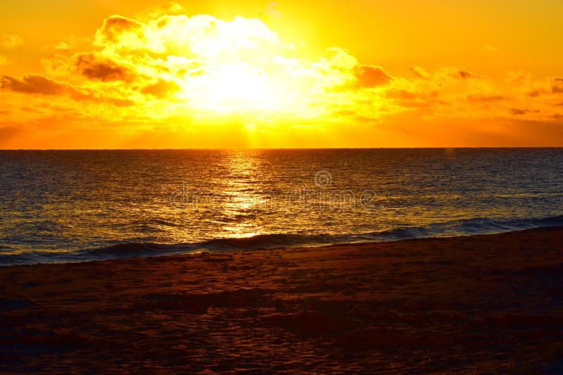 Sunrise over the east coast of Florida. Beautiful golding sunrise with yellow and orange clouds decorates the morning sky royalty free stock image