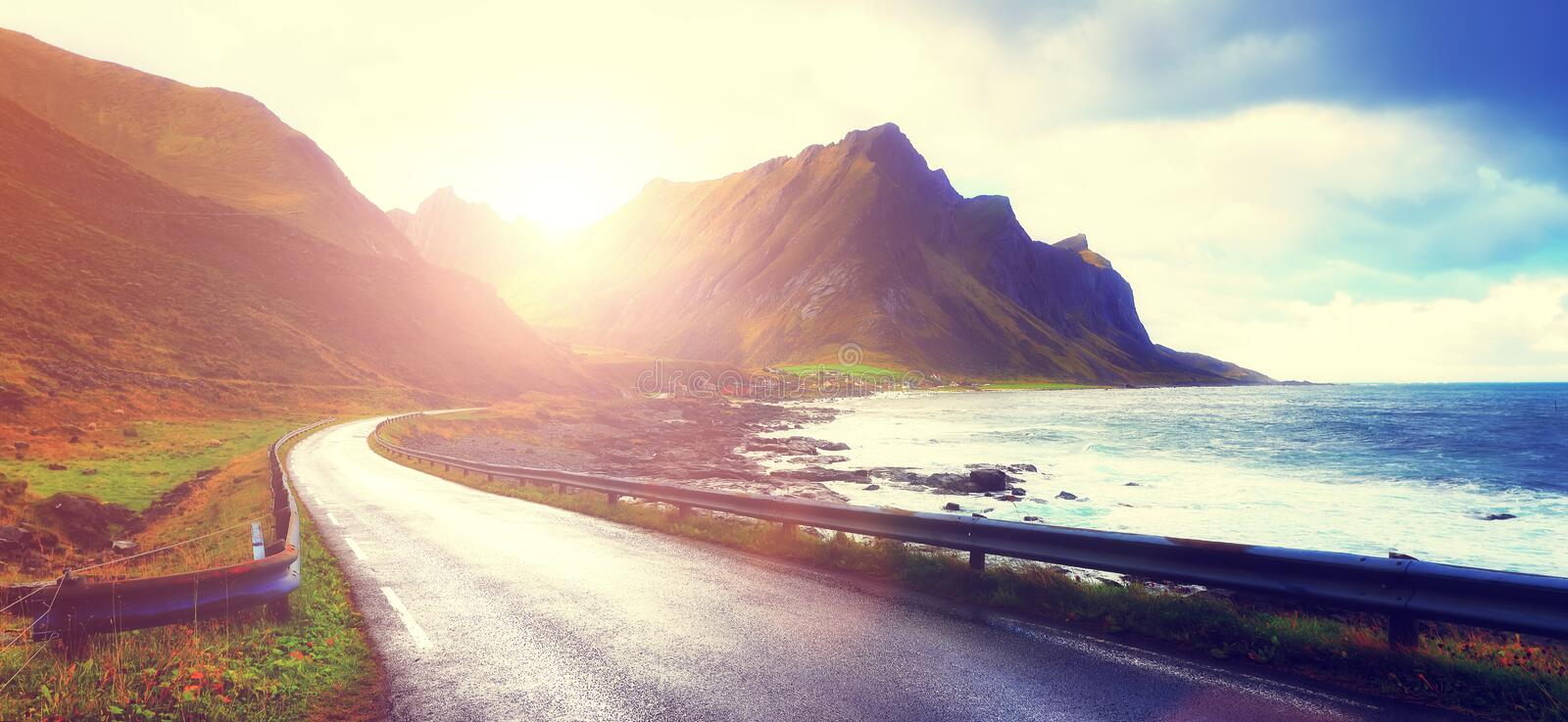 Sunrise over empty road stock images