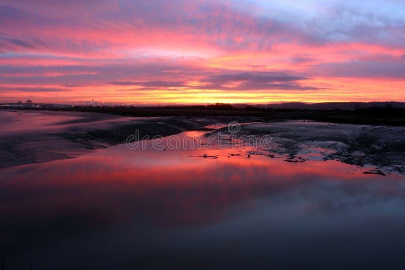 Sunrise over estuary 2. A Dramatic Sunrise over the Severn Estuary stock image