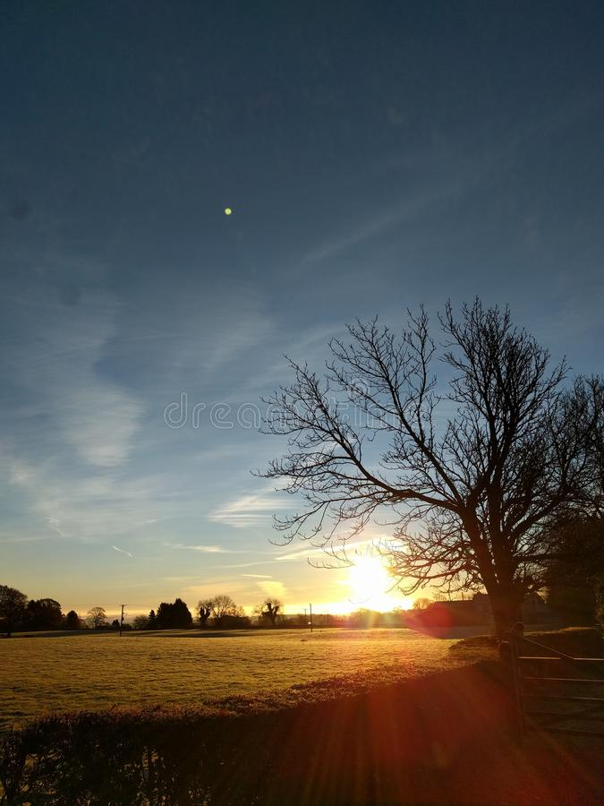 Sunrise over the fields stock photo