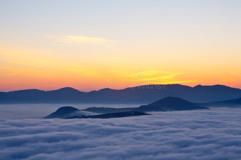 Sunrise over the fog stock image