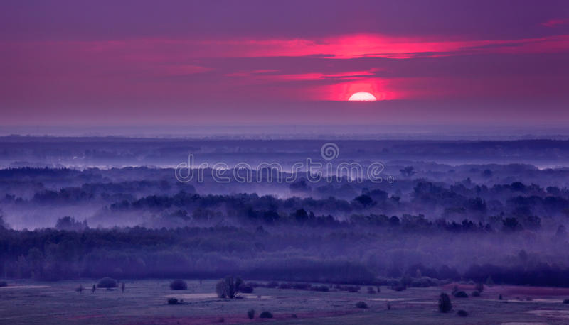 Sunrise over foggy hills. royalty free stock photography