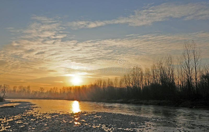 Sunrise over foggy river stock photography