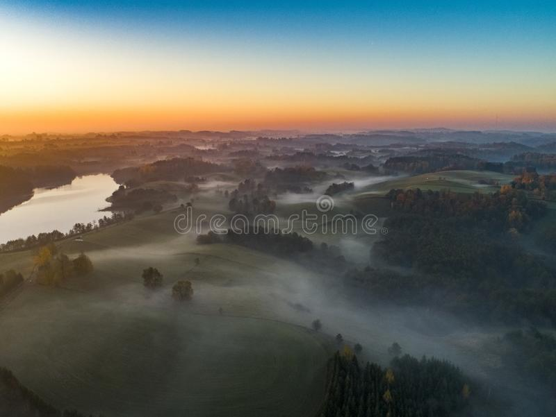 Sunrise over forests and lakes - drone view royalty free stock image