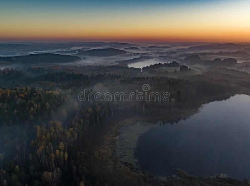 Sunrise over forests and lakes - drone view stock images