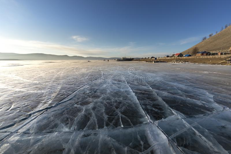 Sunrise over frozen lake Khuvsgul in northern Mongolia royalty free stock images