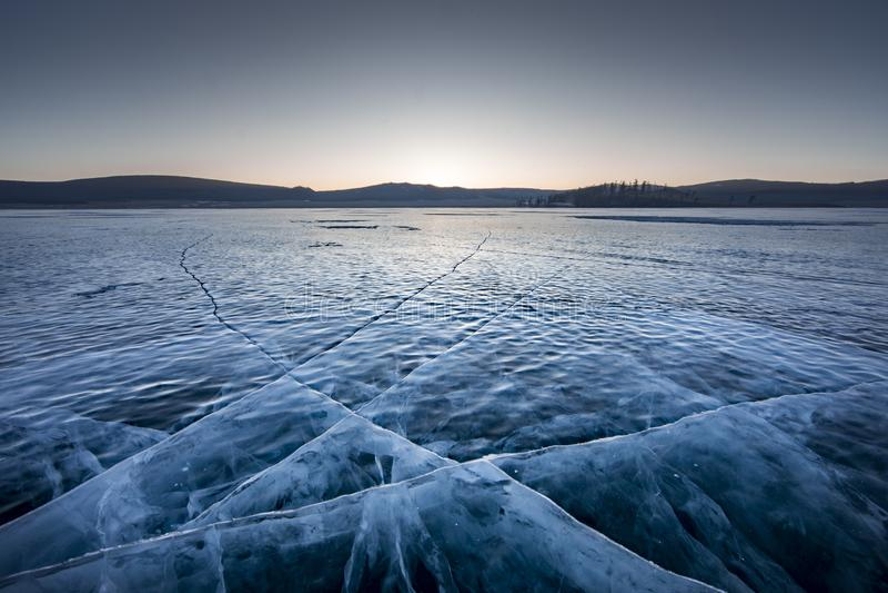 Sunrise over frozen lake Khuvsgul in northern Mongolia royalty free stock image