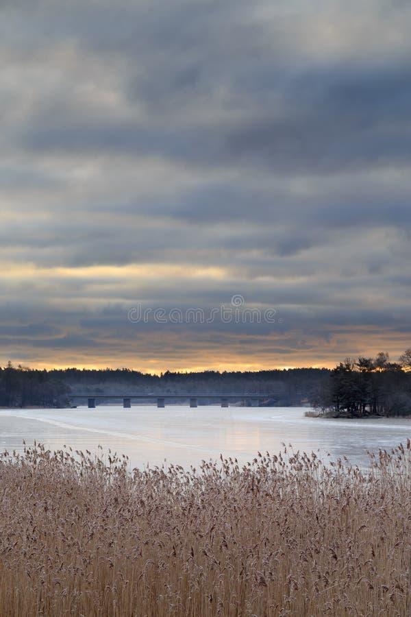 Sunrise over frozen lake. Magelugnen in Farsta in Stockholm, Sweden royalty free stock photo