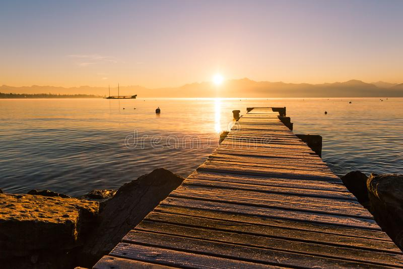 Sunrise over Frozen Wood Pier, Leman Lake and Iconic Snowy Mont-. Blanc stock photos