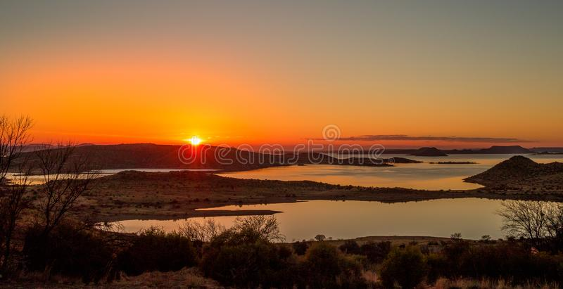 Sunrise over the Gariep Dam in South Africa. Sunrise over the Gariep Dam in the Karoo natural region in South Africa image in landscape format with copy space stock image