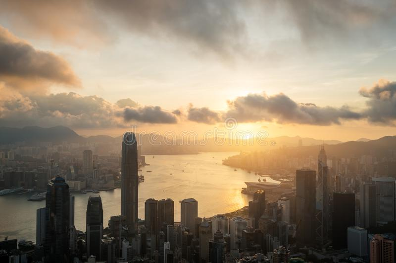 Sunrise over Hong Kong Victoria Harbor from Victoria Peak with H. Ong Kong and Kowloon below royalty free stock images