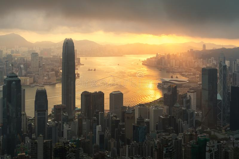 Sunrise over Hong Kong Victoria Harbor from Victoria Peak with H. Ong Kong and Kowloon below stock photography