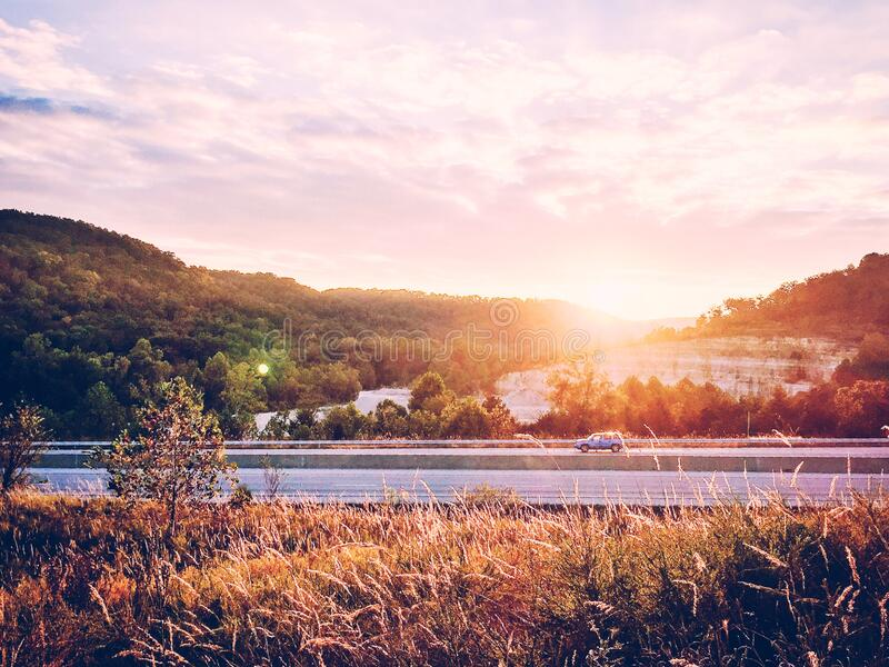 Sunrise over interstate highway stock photography