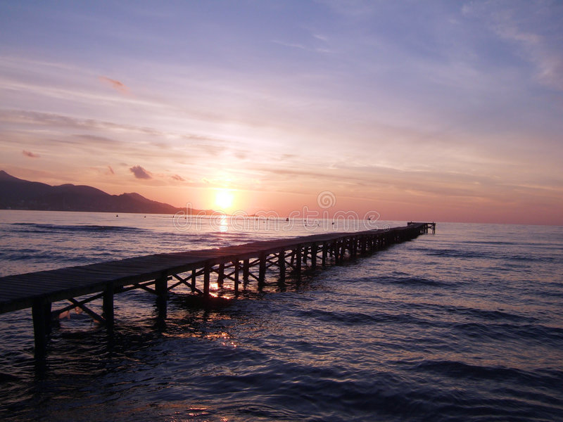 Sunrise over jetty royalty free stock image