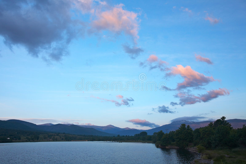 Download Sunrise over the lake stock photo. Image of cloud, landscape - 2546378